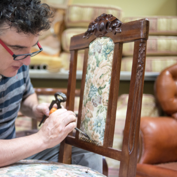 Upholsterer working on a chair