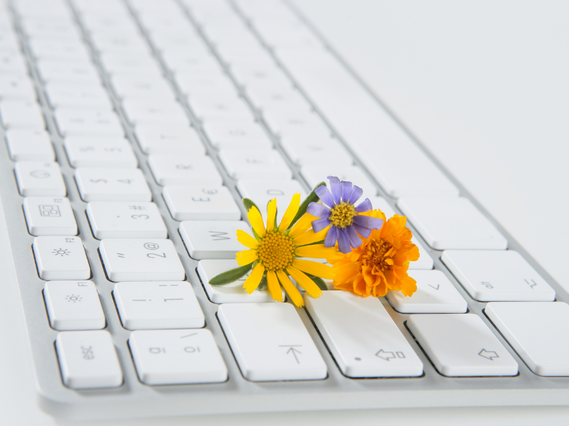 White computer keyboard with three flowers on it