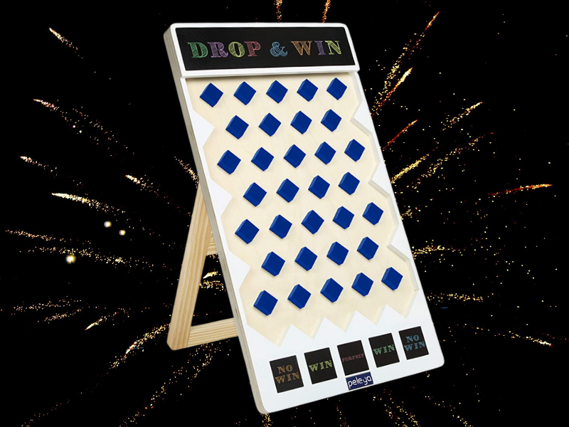 Plinko Game with fireworks in the background